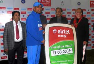 MS Dhoni receiving the man-of-the match award at the post match presentation ceremony