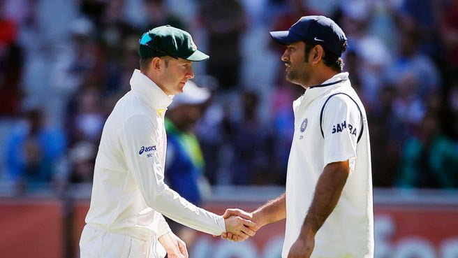 MS Dhoni shaking hands with Michael Clarke