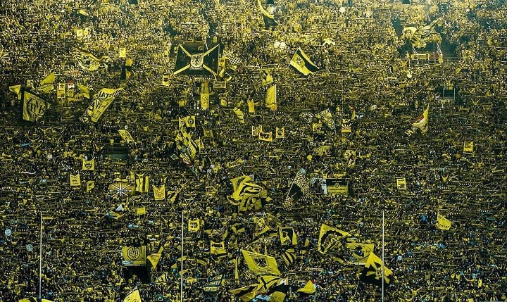 Borussia Dortmund fans cheering for their CLub