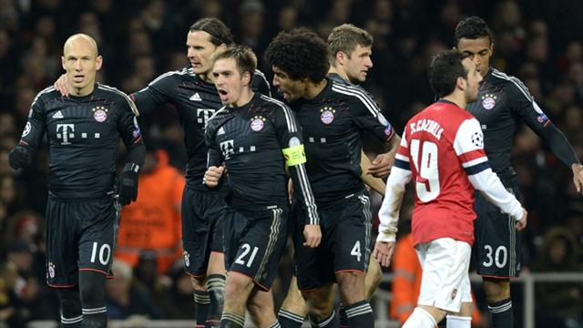Bayern Munich players celebrate after scoring a goal against Arsenal