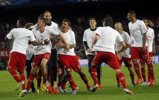 Bayern Munich players celebrate after defeating Barcelona to enter the Finals of 2013 Champions League