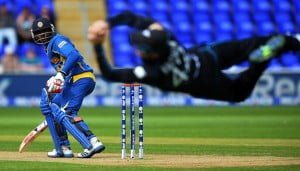 The man flying in the air is Kiwi Skipper Brendon Mccullum. He caught Kushal Perera off the very first ball of the match