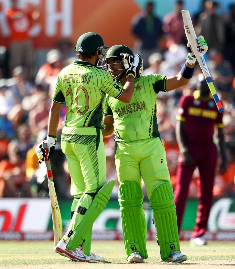 Umar Akmal celebrates his half century. The middle order tried to stabilize.